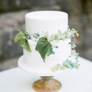 Elegant white wedding cake on Burnett's Boards
