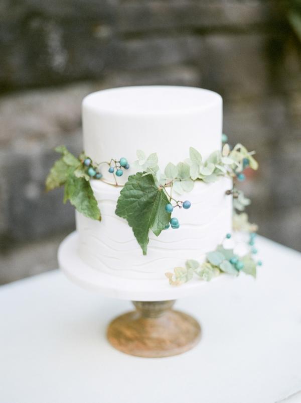 Elegant white wedding cake on Burnett's Boards