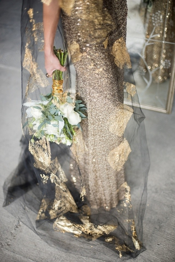 A gold sequins wedding dress with a gold leaf black wedding veil