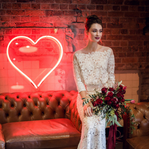 Neon heart sign and bride