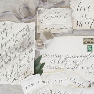 Calligraphy on a Grey Watercolor Wedding Invitation