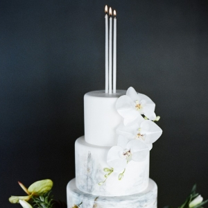 Painted wedding cake with candle cake topper