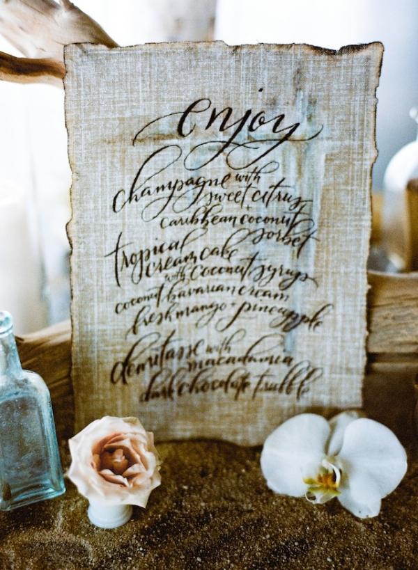 Calligraphy wedding menu on linen