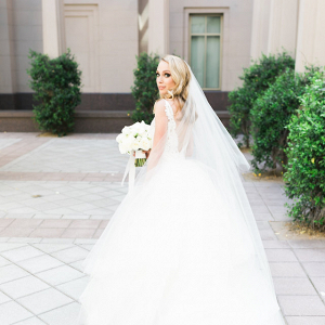 Bride in low back wedding dress