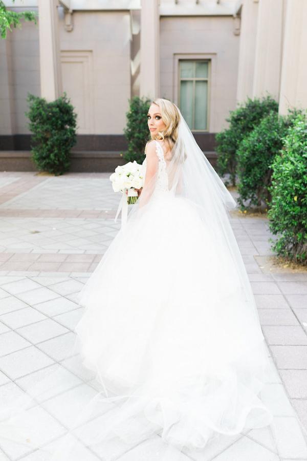 Bride in low back wedding dress
