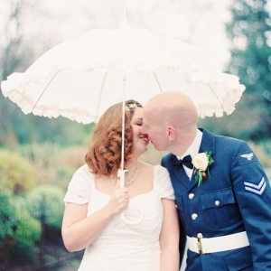 1940s Inspired Bride & Groom Under a Parasol | Photography - Taylor & Porter