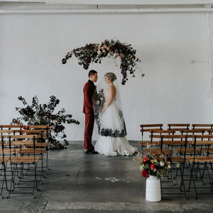 Hanging floral ceremony backdrop