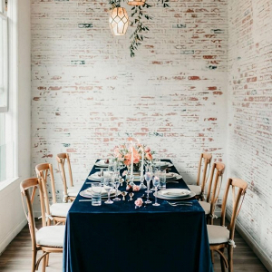 Peach and teal wedding table with velvet linens