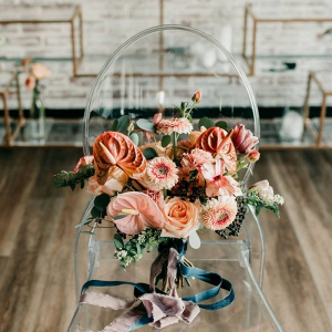 Vibrant peach and coral bridal bouquet