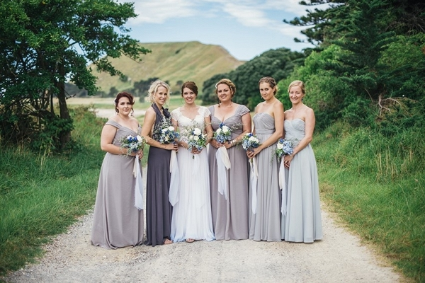 Bridesmaids in mis-matched gray dresses on Chic Vintage Brides