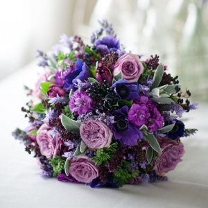 A Hand-Tied Bridal Bouquet of Purple Spring Blooms
