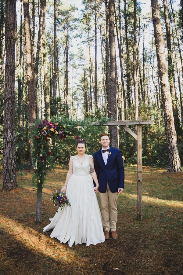 Winter Bride & Groom with Floral Ceremony Arch