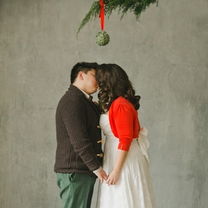 A kiss under a mistletoe ball