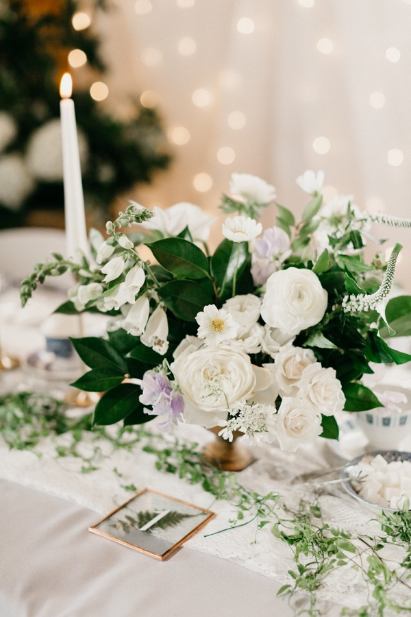 White and periwinkle wedding centerpiece