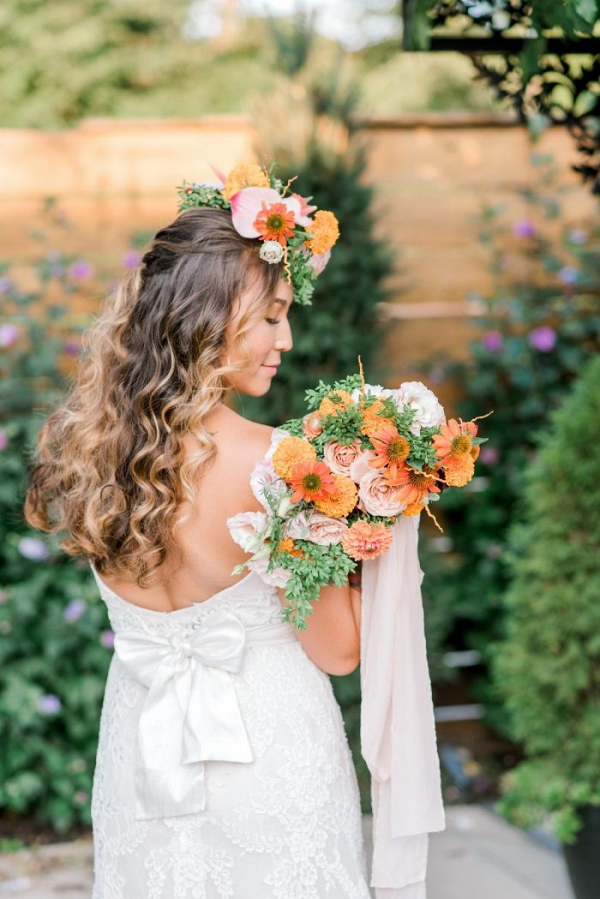Bride with floral crown and orange bouquet