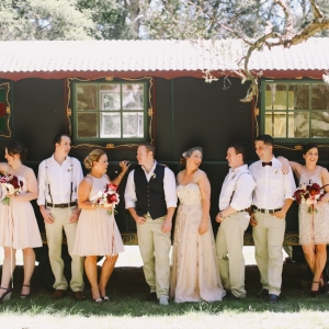 Wedding Party Portrait with a Gypsy Caravan Backdrop. Photography - Lara Hotz