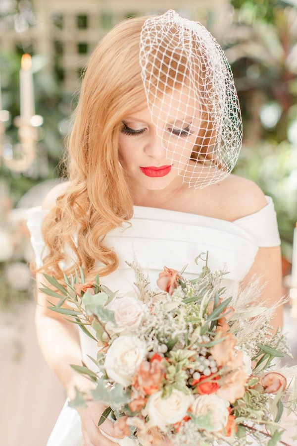 Bride with birdcage veil and red lip