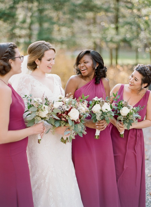 Bridesmaids in long berry dresses