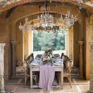 Elegant Chandelier Lit Wedding Table