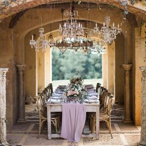 Elegant Chandelier Lit Wedding Table