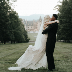 Bride and groom in front of Biltmore Estate