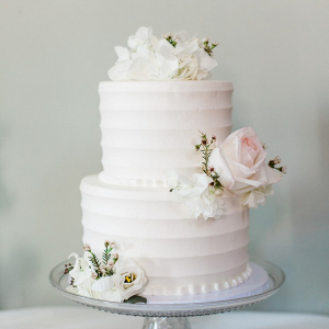 White Wedding Cake topped with Roses