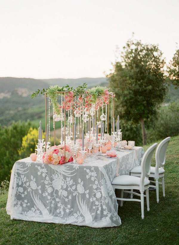 Wedding table with suspended flower and candle centerpiece