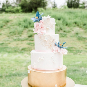Pink and gold wedding cake with sugar flowers