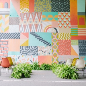 Outdoor Wedding Ceremony with a Bright Painted Backdrop | Photography - Amanda Dumouchelle Photography