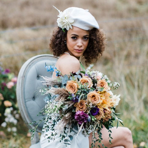 Bride with beret and colorful bouquet
