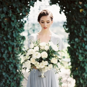 Bride in dusty blue dress on Chic Vintage Brides