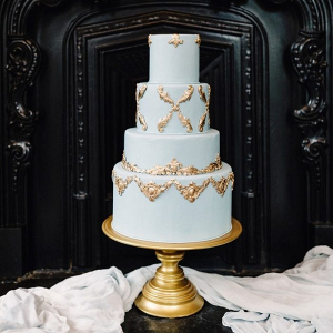 Vintage glam blue and gold wedding cake