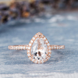 Pear Shaped Topaz Halo Engagement Ring