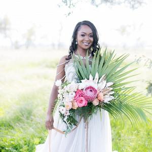 Tropical palm and protea bouquet