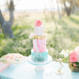 Pink, turquoise, and gold wedding cake