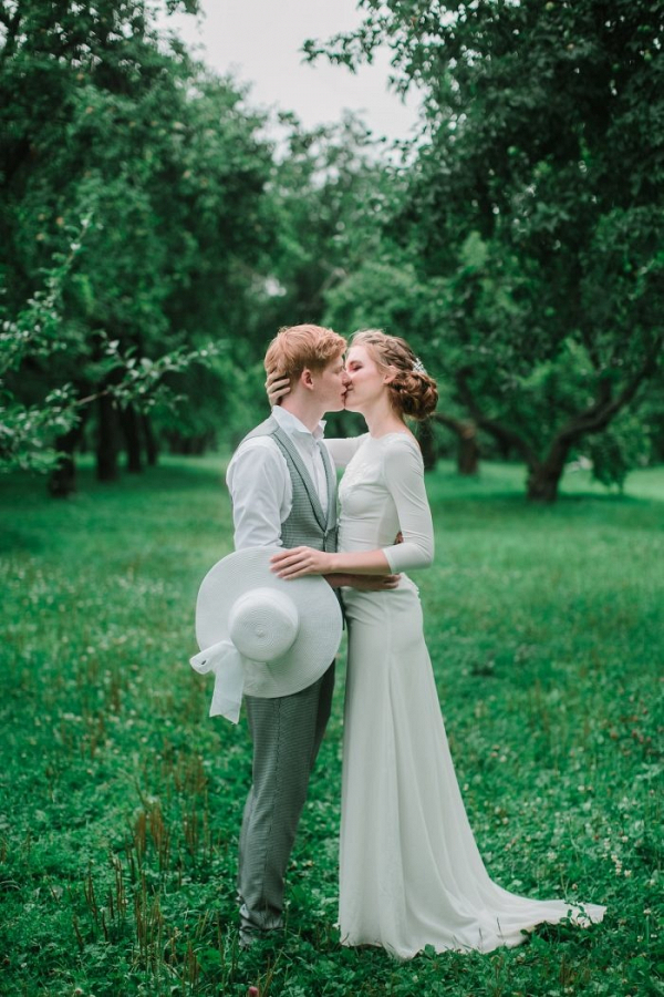 Orchard wedding portrait with hat