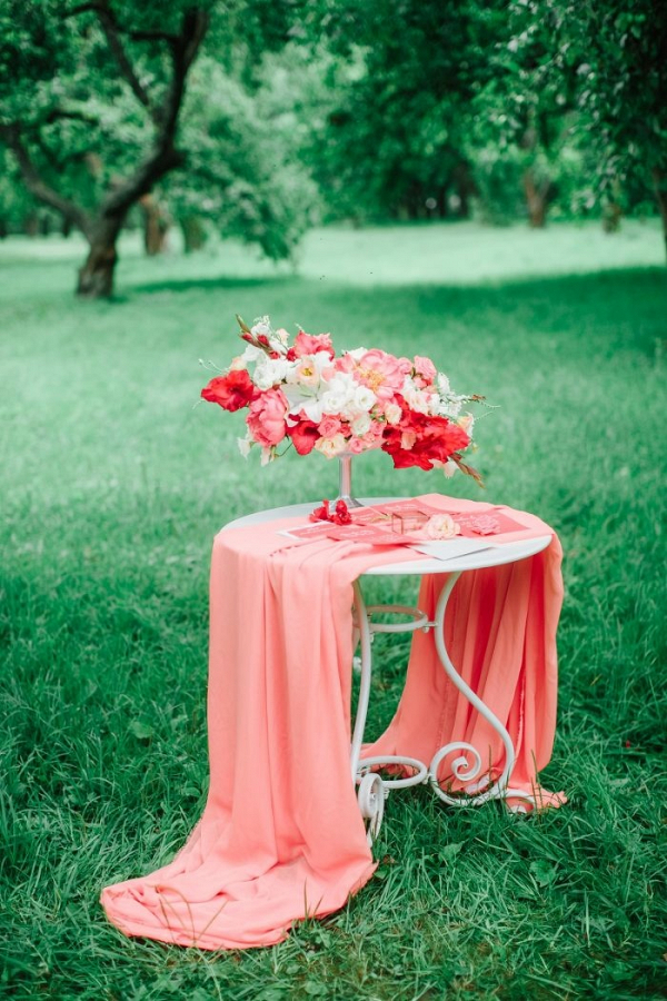 Vibrant coral wedding floral centerpiece