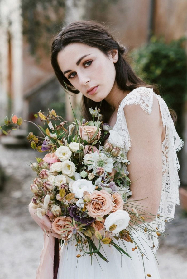 Vintage bride with lush and wild bouquet