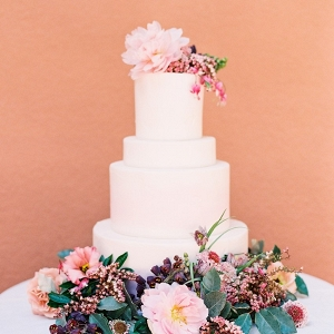 White wedding cake with flowers on Chic Vintage Brides