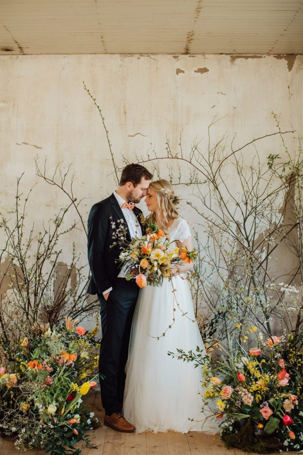 Floral and branch ceremony backdrop