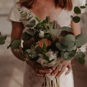 Greenery and burgundy flower bouquet with macrame wrapper