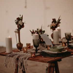 Industrial boho wedding table with macrame runner