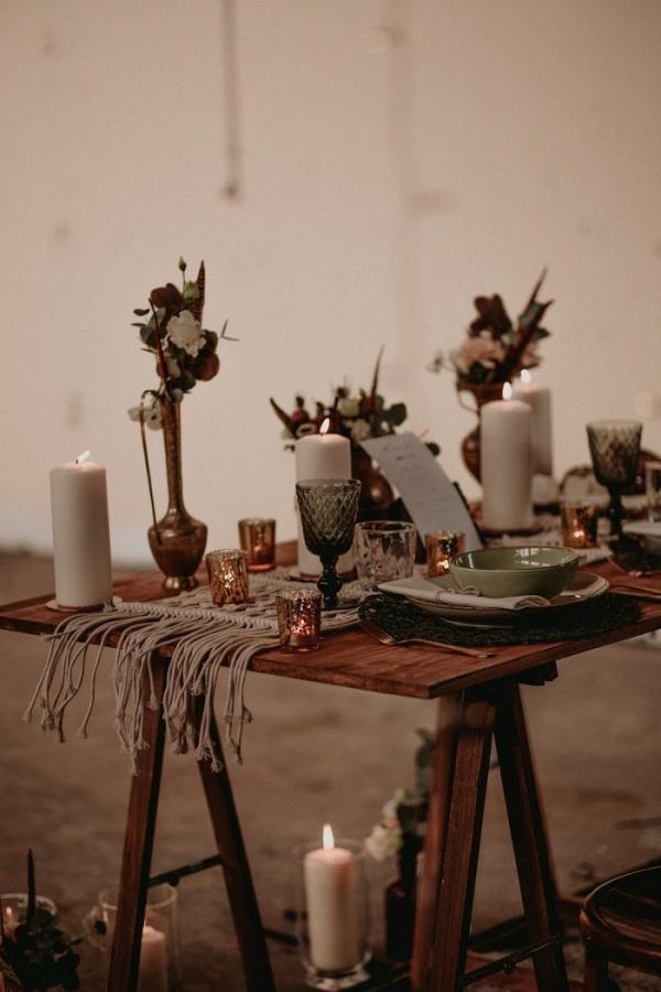 Industrial boho wedding table with macrame runner