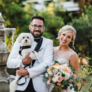 Vintage bride and groom portrait with dog