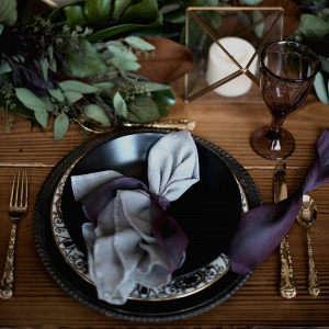 Purple and green wedding place setting