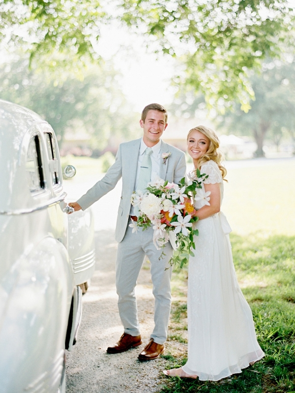 Bride and groom at getaway car on Chic Vintage Brides
