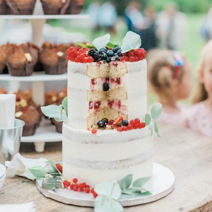 Semi naked berry filled wedding cake