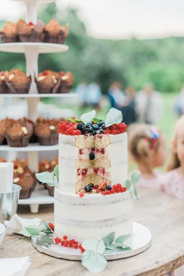 Semi naked berry filled wedding cake