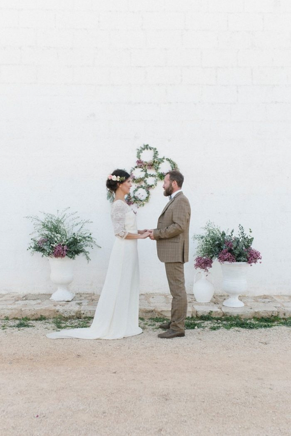 Ceremony with floral hoop backdrop