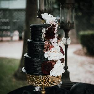 Black wedding cake with burgundy florals